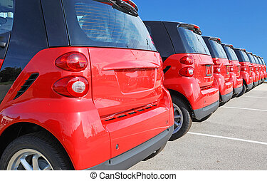 new cars - red cars in the line in the automobile dealership