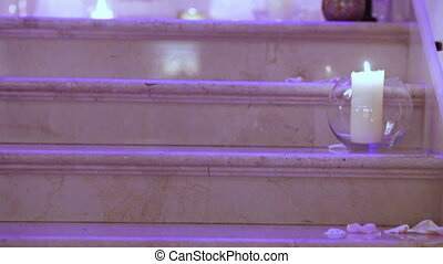 Candles on steps - Burning candles on marble steps