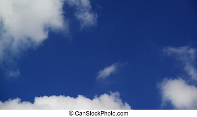 Passing of time metaphor. Time lapse footage of blue sky...