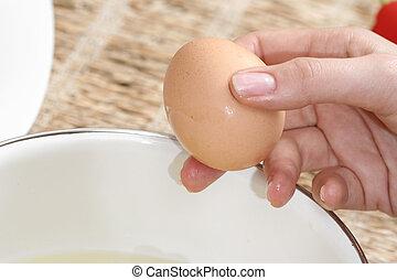 Broken eggs  - Close-up picture of hands broking eggs.