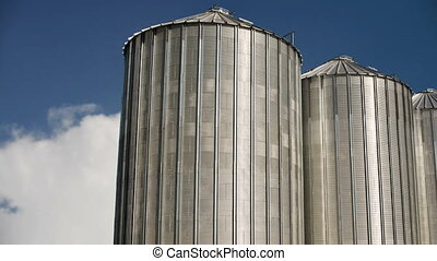 Grain Silos under Clouds time lapse footage. Agricultural...