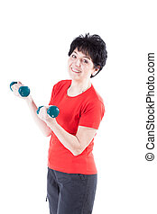 Smiling woman with dumb-bells - A smiling middle-aged woman...
