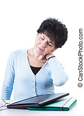Painful back at work - An older woman suffering from a...