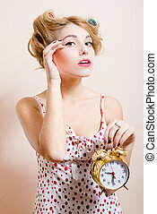 attractive funny young blond pinup woman with alarm-clock...