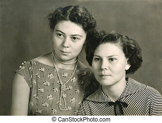 Vintage portrait of two attractive women - Vintage sepia...