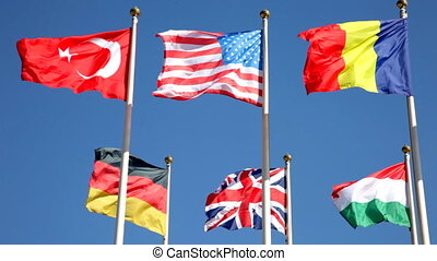 national flags of various countries  against a blue sky