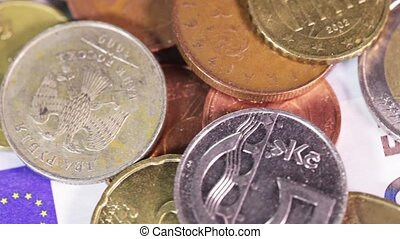 Money Macro - Banknotes and coins on rotating surface on...