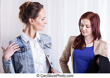 Friends trying on jacket - Friends during trying on denim...