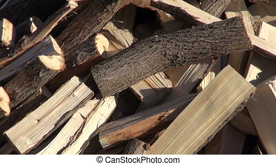 chopped firewood  stack in old farm garden