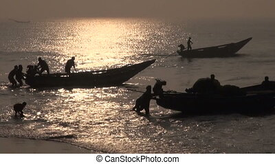 fishermens silhouette and boats
