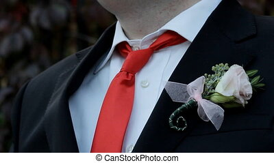Groom straightens tie