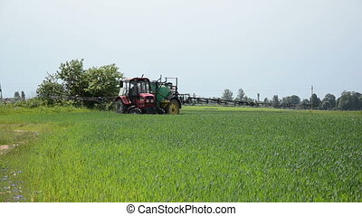 spring crop tractor - beautiful red tractor with a long...