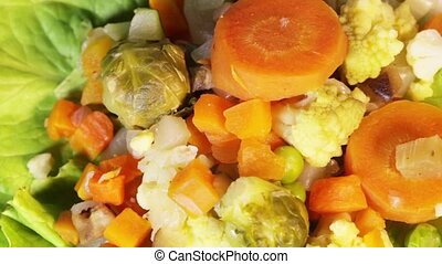 Boiled vegetables - Assorted vegetables steamed rotating...