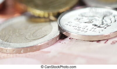 Macro Coins and Banknotes - Banknotes and coins on rotating...