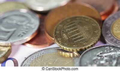 Coins and Banknotes - Banknotes and coins on rotating...