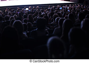 People seated in an audience - View from the back of a...