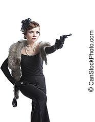 Woman wearing a black dress with gun