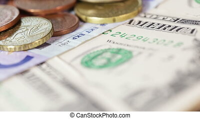 Macro money coins - Banknotes and coins on rotating surface...