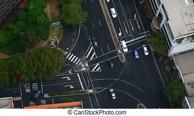Urban traffic - Urban road intersection with passing cars