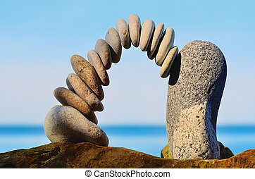 Steadiness - Balancing of pebbles each other on the seacoast