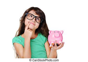 dreaming girl holding piggy bank