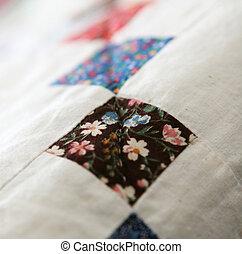 Patchwork Quilt - Patchwork quilt repating squares detail