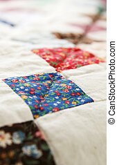 Handmade Quilt - A handmade patchwork quilt repating square...