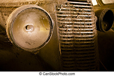Eyes of a car - Vintage car wreck on a junkyard,...