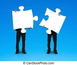 Two businessmen assembling puzzles blue background
