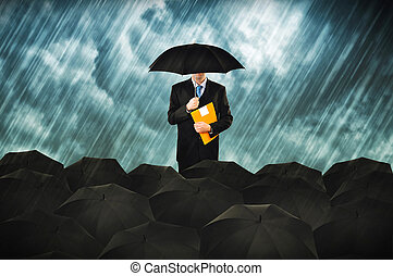 Insurance agents in heavy rain Businessmen with umbrella...