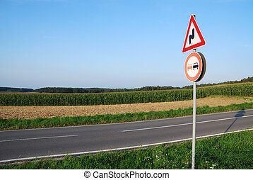 Traffic sign - Landscape with a traffic sign: Don\'t...