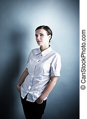 Young beautiful woman on gray background.