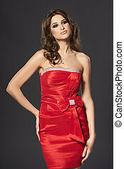 Fashion woman in bright red cocktail dress