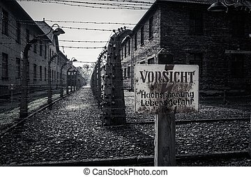 Electric fence and warning sign in former Nazi concentration...