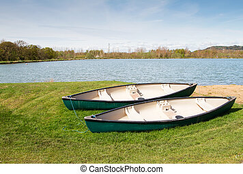 Two canoes near to a lake