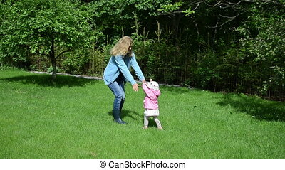 nanny child park - nanny have fun with the little girl in...