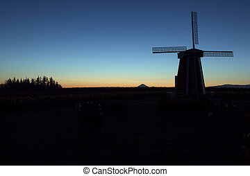 Silhouette of Windmill at Sunrise