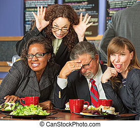 Business People in Awkward Pose - Embarrassed man with...