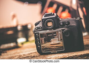 Food Photography. Professional Digital Camera with Table...