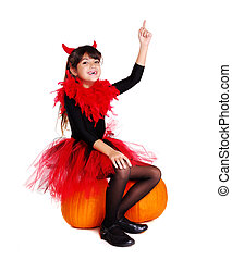 girl wearing halloween devil fancy dress