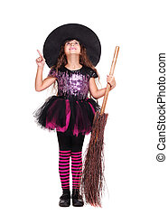 halloween witch pointing to the copy space area full length