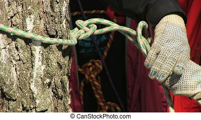 Man tying a knot in a climbing rope