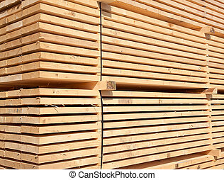 Fresh wooden studs - Stack of new wooden studs at the lumber...