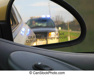 Traffic Stop - A vehicle is pulled over by police and...