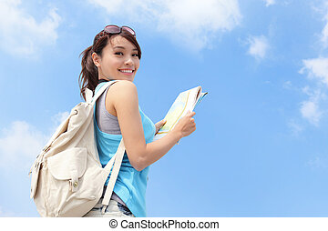 Happy travel woman look map and look to you with sky...