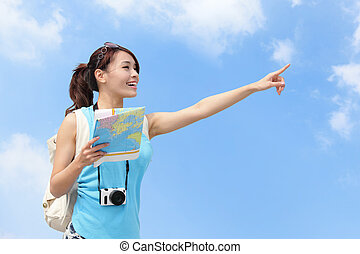 Happy women traveler pointing copy space with map in the sky
