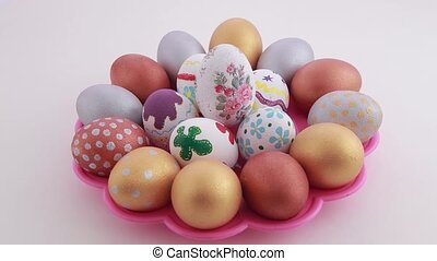 Colorful easter eggs isolated over white background Rotation...