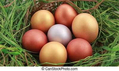 Golden Easter eggs on grass Rotation
