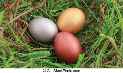 Three Golden Easter eggs on grass