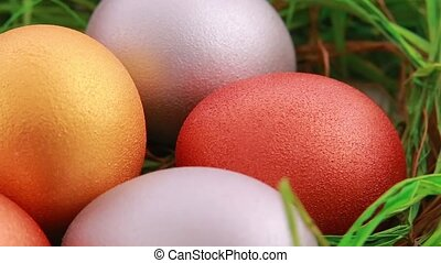 Golden Easter eggs on grass Close up